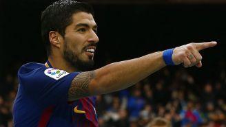 Luis Suárez celebra una anotación contra Celta en Camp Nou