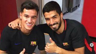Coutinho y Suárez sonríen en el vestidor del Barcelona