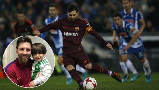 Messi saca un disparo en un partido y posa con Máximo en una foto