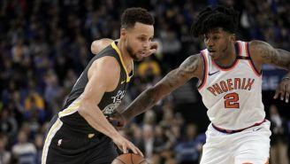 Curry intenta escaparse con el balón