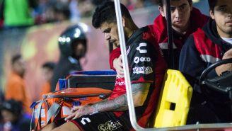 Gustavo Bou sale en camilla en el encuentro de Xolos contra Pumas