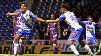 Hugo Rodríguez festeja un gol con Puebla en el C2018