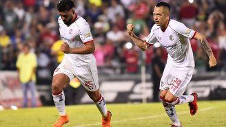 Jugadores del Toluca festejan un gol