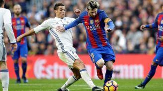 CR7 y Messi, durante un Clásico de España