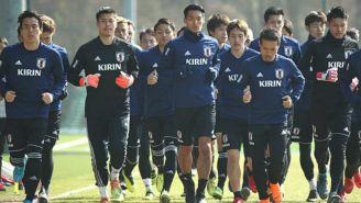 Seleccionados de Japón corren en un práctica