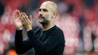 Pep Guardiola aplaude durante un partido de futbol