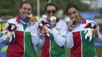 Román, Valencia y Vázquez, con la medalla de oro en los JCC