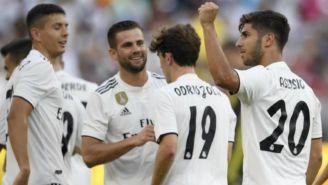 Odriozola y Asensio celebran un gol con el Madrid