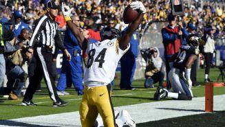Antonio Brown celebra luego de anotar un touchdown