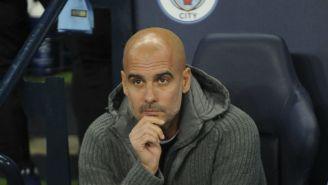 Guardiola observa un juego del Man City