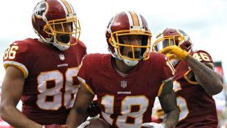 Jugadores de Washington celebran un touchdown