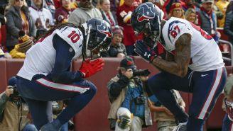 Hopkins y Demaryius Thomas celebran anotación contra Redskins