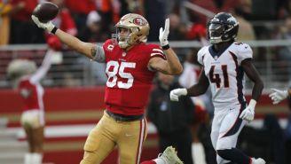 Greg Kittle festeja una anotación de los 49ers vs Denver