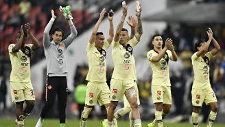 Jugadores del América aplauden tras eliminar a Pumas