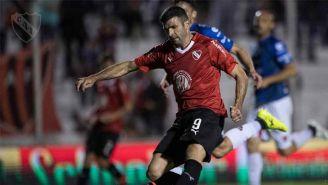 Emmanuel Gigliotti en un partido con Independiente