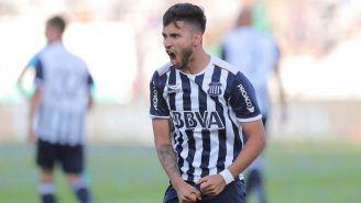 Bustos festeja un gol con Talleres