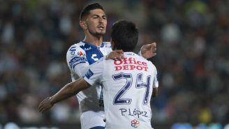 Víctor Guzmán y Pablo López festejan un gol