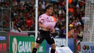 Fernando González celebra anotación contra Atlas
