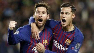 Coutinho y Messi festeja un gol vs el Man Utd