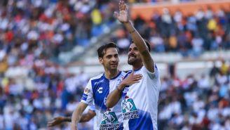 Raúl López y Franco Jara festejan un gol