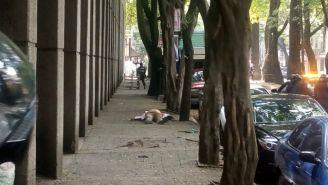 El presunto asaltante tirado en el suelo
