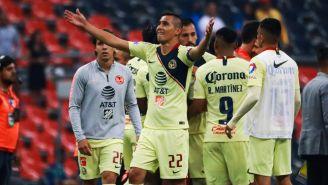 Paul Aguilar celebra un gol con el América