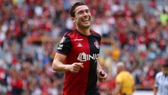 Juan Pablo Vigón festeja un gol con Atlas