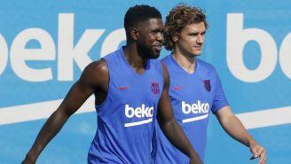 Umtiti y Griezmann en un entrenamiento con el Barcelona