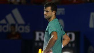 Grigor Dimitrov se lamenta durante una competencia en México