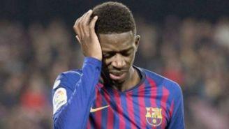 Ousmane Dembélé adolorido en un partido con Barcelona