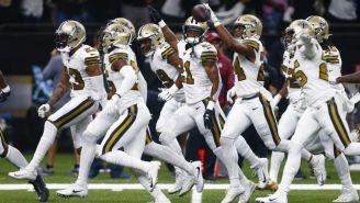 Jugadores de Saints, en festejo contra Dallas