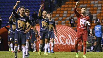 Jugadores de los Pumas en su último juego en Puebla