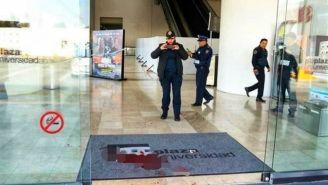 Policías después del atentado en Plaza Universidad