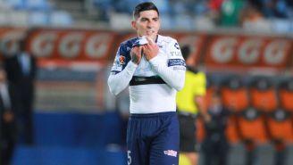 Víctor Guzmán en partido de la Liga MX