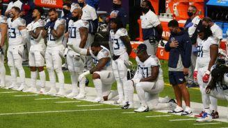 Jugadores de los Titans ante los Vikings