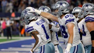 Jugadores de Dallas celebran TD frente a Eagles