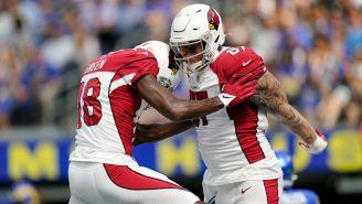 Jugadores de Cardinals celebran vs Rams