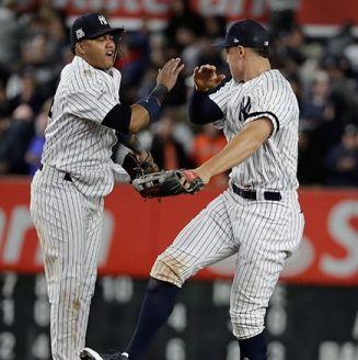 Castro y Aaron Judge celebran la victoria de Yankees