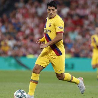 Luis Suárez conduce el balón en juego contra  Athletic Club de Bilbao