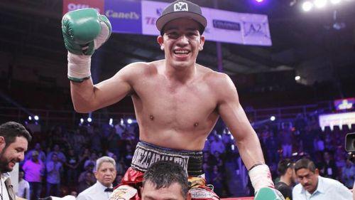 David Sánchez celebra tras ganar una pelea