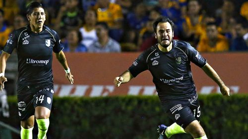 Luis Márquez festeja su gol contra Tigres