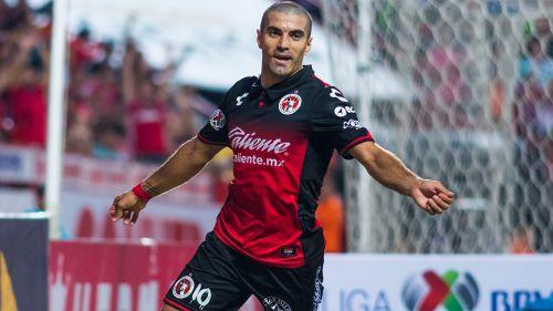 Malcorra festeja un gol con Xolos