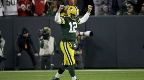 Aaron Rodgers festeja una anotación con los Packers