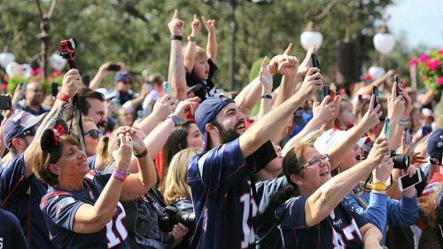 Fans de los Patriots en el desfile del Campeón