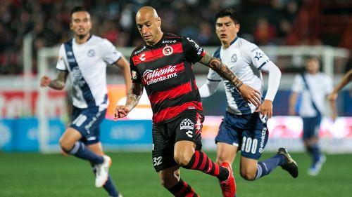 Ariel Nahuelpán, durante juego contra Puebla
