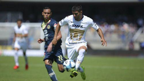 Aguilar y Malcorra, en un partido en CU