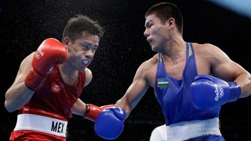 Misael Rodríguez y Bektemir Melikuziev en una pelea