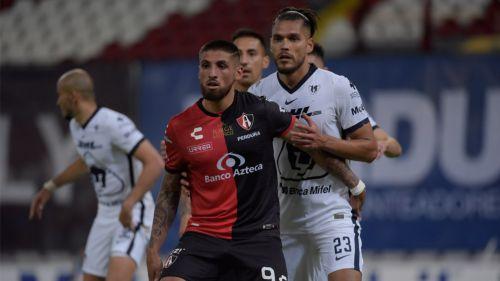Ignacio Jeraldino y Nicolas Freire, durante el juego