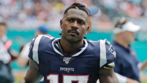 El exreceptor de la NFL, en un partido con Patriots