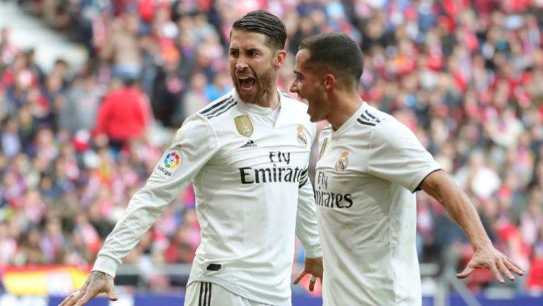 Sergio Ramos y  Lucas Vázquez  festejan un gol vs el Atleti